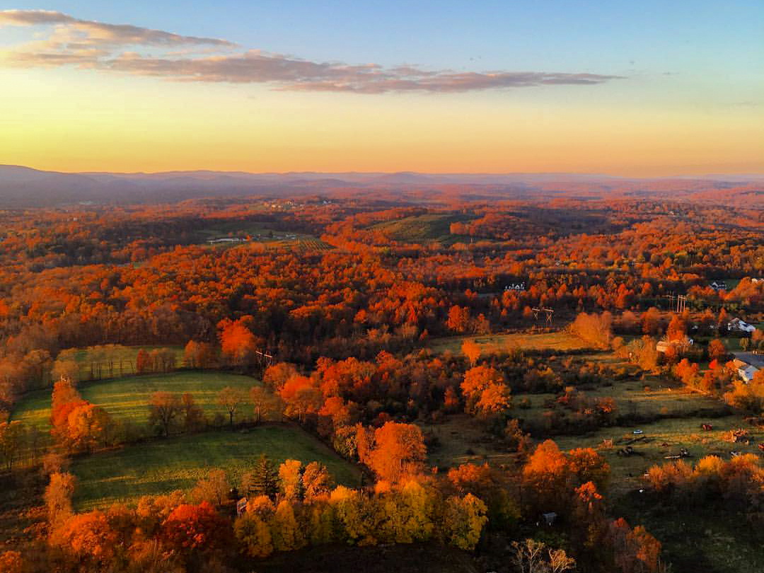fall foliage helicopter tour at sunset